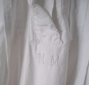 Hand embroidered cotton Monogram.