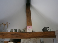 Pewter teapot and a reminder of Blighty balanced on the beams!